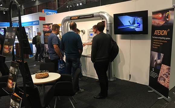 Atexon staff giving a presentation in Göthenburg exhibition in 2016